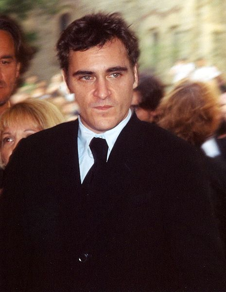 Dark haired man in black suit