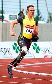 Man running on long black, springy blades.