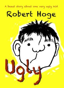 Yellow book with cartoon ugly face with author Robert Hoge's name on it.