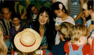 Cher with kids with cleft lip and other facial differences. .
