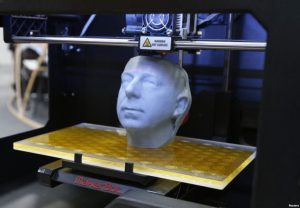 White head in middle of box-like 3d-printer for cleft lip & palate surgery