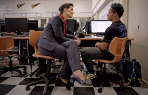 Oakland Mayor Libby Schaaf sitting next to a student at a computer.
