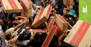Black Friday shoppers struggling over merchandise - Materialism, Consumerism, Overindulgence and Bullying.