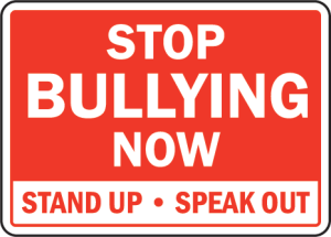 Stop Bullying sign in red and white.