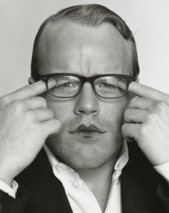 A young Philip Seymour Hoffman pulls eyelids down under his glasses