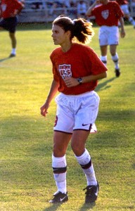 Mia Hamm -YOUNG WOMAN IN SHORTS ON SOCCER FIELD
