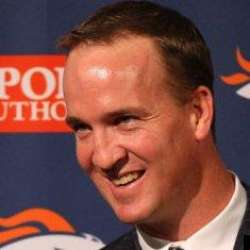 Peyton Manning out of uniform smiling.