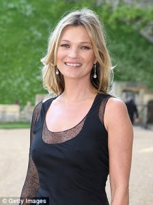 Model Kate Moss in black dress and shoulder-length hair..