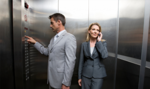 Male and female showing male privilege in elevators.