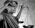 Lady w scales peeks from under her blindfold, leading to not-blind justice