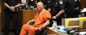 The Golden State Killer? Joseph DeAngelo seated in orange prison garb.