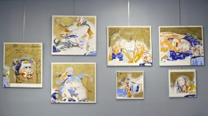 All Seven Deadly Sins paintings at a recent exhibit. 7 paintings hung on a gunmetal grey wall.