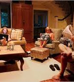 Can you find the Cleft Heart reader in living room with several people