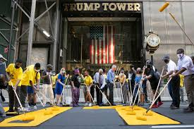 White Privilege and BLM - people painting street in front of Trump Tower.
