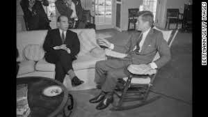 JFK in rocking chair for his back.